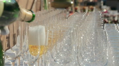 Waiter fills empty glasses with champagne at a banquet Stock Footage