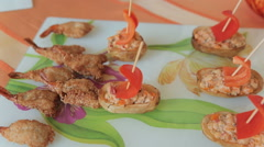Potato stuffed with salad in the form of boat and fried shrimp at a banquet Stock Footage