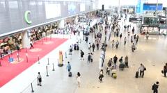 People walking in the Shanghai Hongqiao International Airport - stock footage