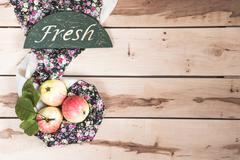 Ripe seasonal apples on the wooden backround - stock photo