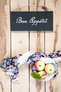 Stock Photo of Ripe seasonal apples on the wooden backround