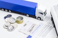 Tachograph with lorry..shows its good way to earn proper wage.... - stock photo