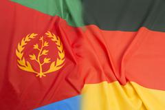 Eritrea flag vs. Germany flag Stock Photos