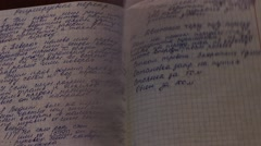 Pages of Russian student notes at the wind Stock Footage