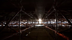 Industrial.Interior structure,of a big building.Scaffolding,work in progress Stock Footage