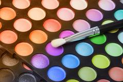 Make up pallet with brush . - stock photo