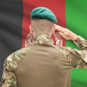 Soldier in hat facing national flag series - Afghanistan - stock photo