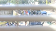 Crowd and Window Blind Stock Footage