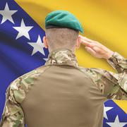 Stock Photo of Soldier in hat facing national flag series - Bosnia and Herzegovina