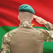 Soldier in hat facing national flag series - Burkina Faso - stock photo