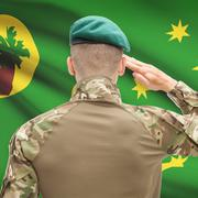 Soldier in hat facing national flag series - Cocos (Keeling) Islands - stock photo