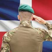 Soldier in hat facing national flag series - Dominican Republic Stock Photos