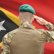 National military forces with flag on background conceptual series - East Tim Stock Photos