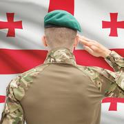 National military forces with flag on background conceptual series - Georgia - stock photo