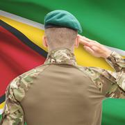 National military forces with flag on background conceptual series - Guyana - stock photo