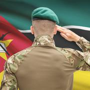 Stock Photo of National military forces with flag on background conceptual series - Mozambiq