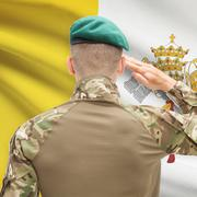 Soldier in hat facing national flag series - Vatican City - stock photo