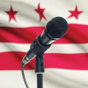 Stock Photo of Microphone on stand with US state flag on background - District of Columbia