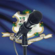 Microphone on stand with US state flag on background - Connecticut - stock photo