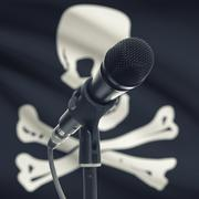 Microphone on stand with flag on background - Jolly Roger Stock Photos