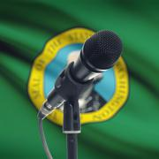 Microphone on stand with US state flag on background - Washington - stock photo