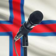 Microphone on stand with national flag on background - Faroe Islands - stock photo