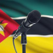 Stock Photo of Microphone on stand with national flag on background - Mozambique