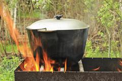 Pot water on the fire - stock photo
