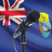 Microphone on stand with national flag on background - Saint Helena Stock Photos