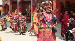 Tibetan men in mystical masks perform ritual Tsam dance. Lamayuru, Ladakh, India Stock Footage
