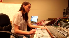Female Audio Engineer at Console (Color) Stock Footage