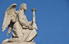 Angel with blue sky and copy space Kuvituskuvat