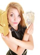 Stock Photo of Woman with gift box and polish money banknote.