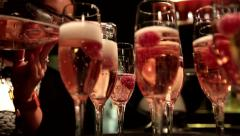 Champagne Pouring into Wine Glasses with Raspberries, Party at a Bar/ Nighclub - stock footage