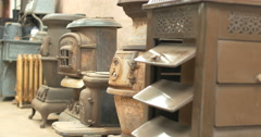 4K Display of vintage antique wood coal stoves Stock Footage