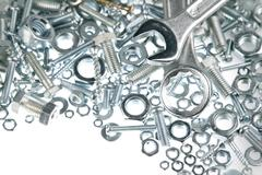 Wrenches on nuts and bolts - stock photo