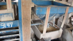 Pan shot of rice cleaning machine.  Stock Footage