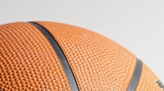 Basketball With Hand on It and Isolated on White, 4K Stock Footage