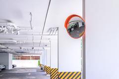 Traffic convex mirror at car park. Stock Photos
