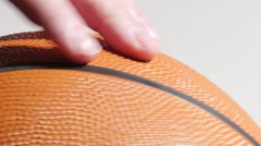 Basketball Spinning in Hand and Isolated on White, 4K - stock footage