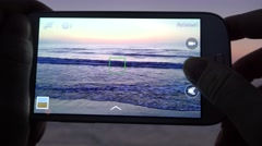 4K Woman take photo sunset sea mobilephone smartphone romantic ocean day sunrise Stock Footage