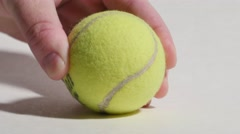 Tennis Ball Being Placed Down Isolated on White, 4K Stock Footage