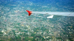 Aerial Cityscape with Plane's Wing in Frame Stock Footage