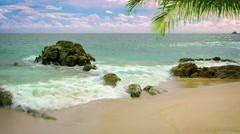 Gentle Waves Wash Over a Rocky, Tropical Beach Stock Footage
