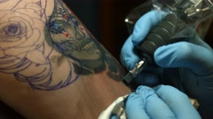 Tattoo Artist Working on Sugar Skull Close Up Stock Footage