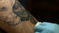 Elegant Shot of Tattoo Artist Working on Sugar Skull Tattoo Stock Footage