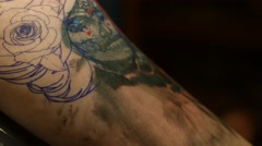 Day of the Dead Sugar Skull Tattoo on Woman's Arm Stock Footage
