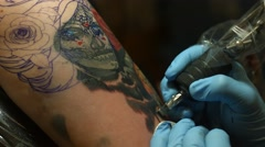 Close up Shot of Woman's Arm Getting Tattooed Stock Footage