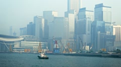 Modern, Urban Buildings in the Fog over a Busy Harbor Stock Footage