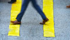 Feet and Legs of Pedestrians Crossing an Urban Street Stock Footage
